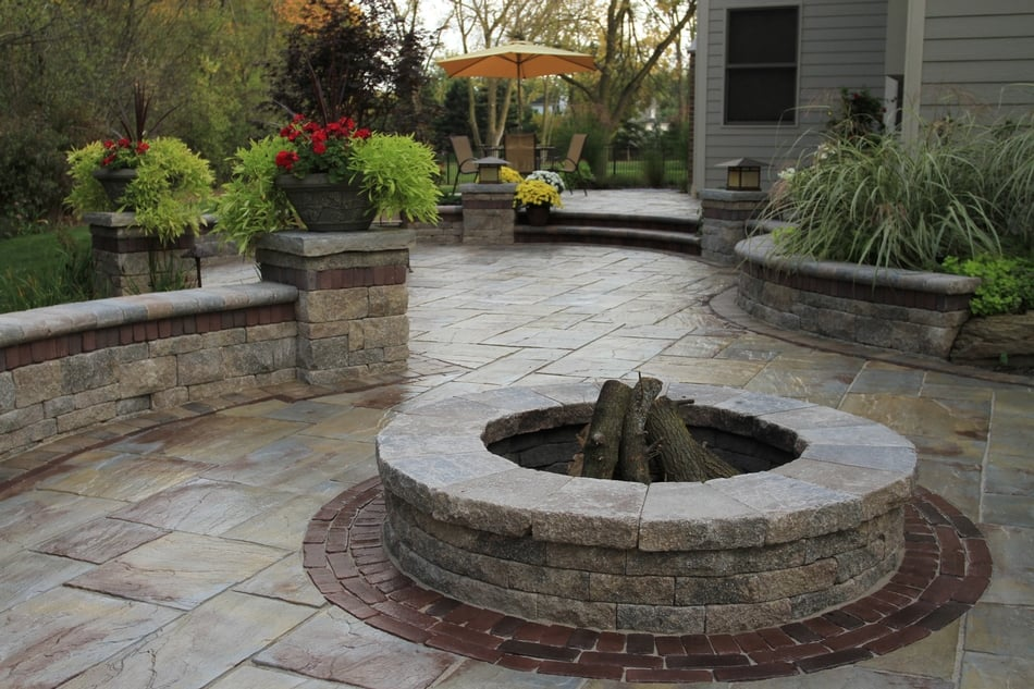 Photo of Stone Gallery Landscape & Masonry Supply - Newton, MA, United  States. - Unilock Rivenstone Patio With Copthorne Accent And Fire Pit. - Yelp