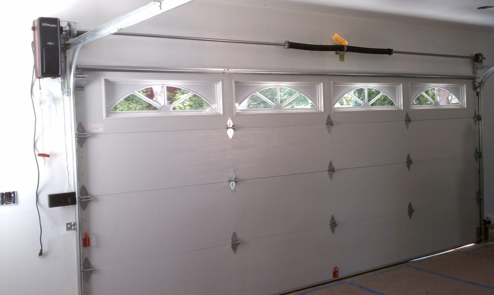 new steel back insulated sectional garage door with