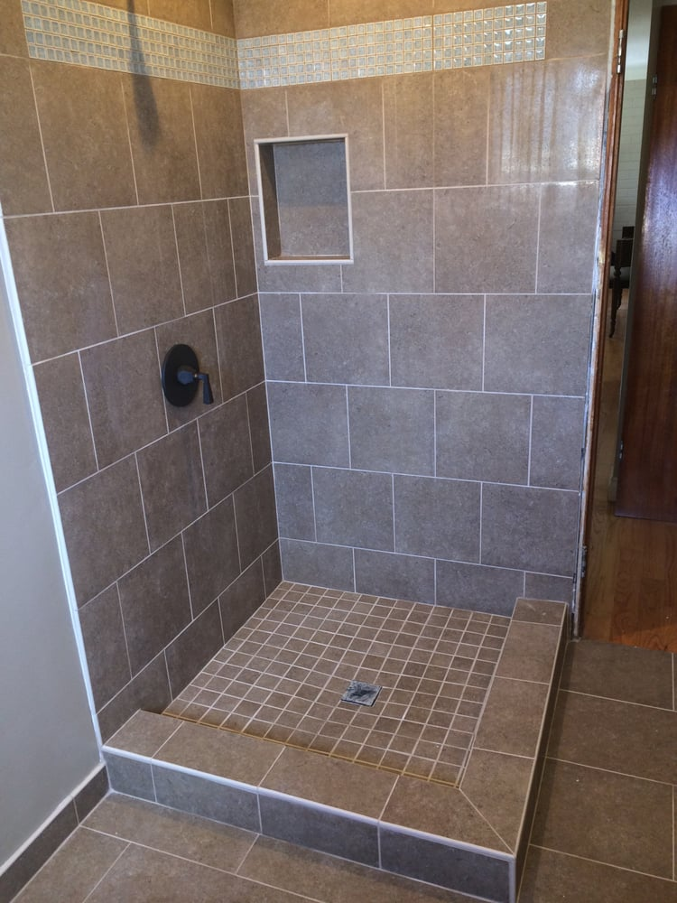 Unique  Grey Bathroom With The Same Tiles In The Shower And A Different Floor