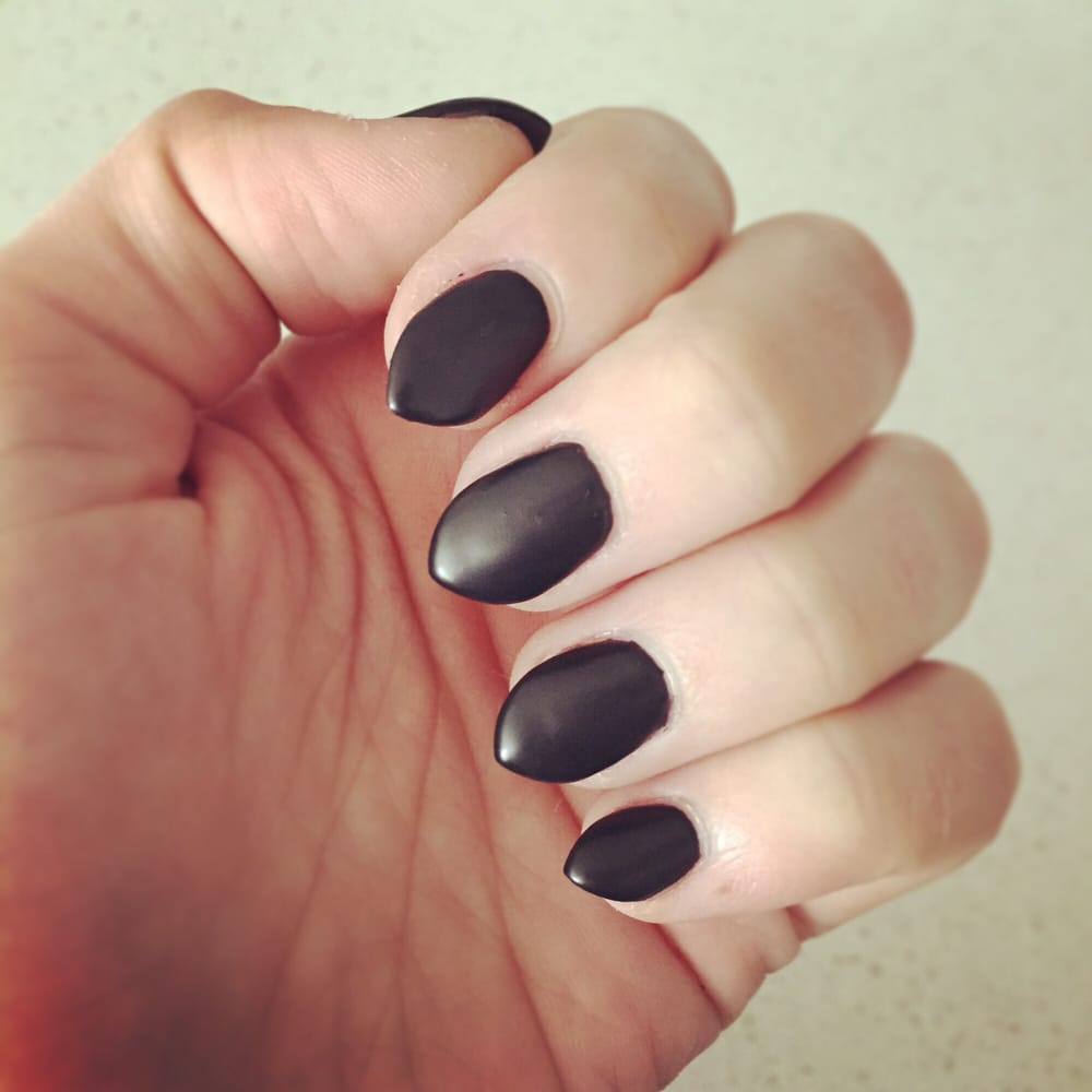 Short, cat nails with black matte gel. Totally rad. - Yelp