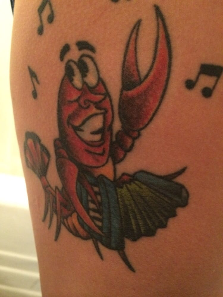 Crawfish playing an accordion an ode to my cajun heritage for South street tattoo