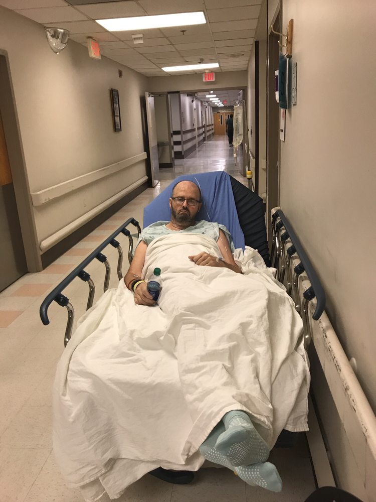 Husband in hallway because no rooms in ER - Yelp