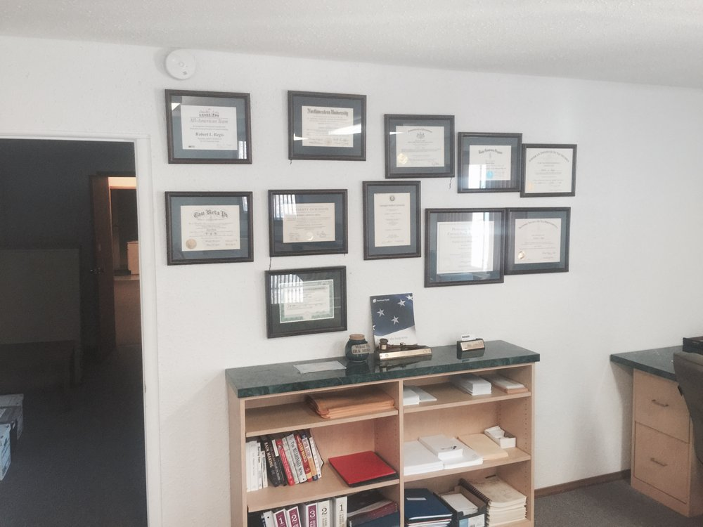 Bob\'s wall of professional licenses and certificates. You get more ...