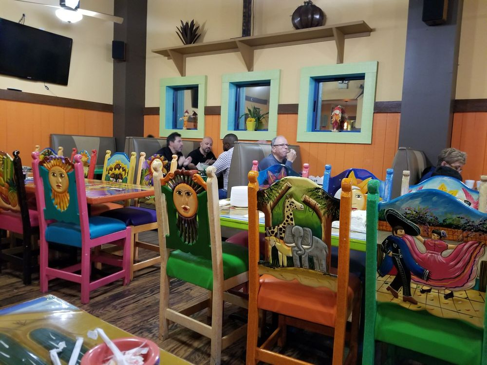 Photo of Chanou0027s Mexican Grill - Little Rock AR United States. Hand carved & Hand carved and painted authentic mexican tables and chairs.... they ...