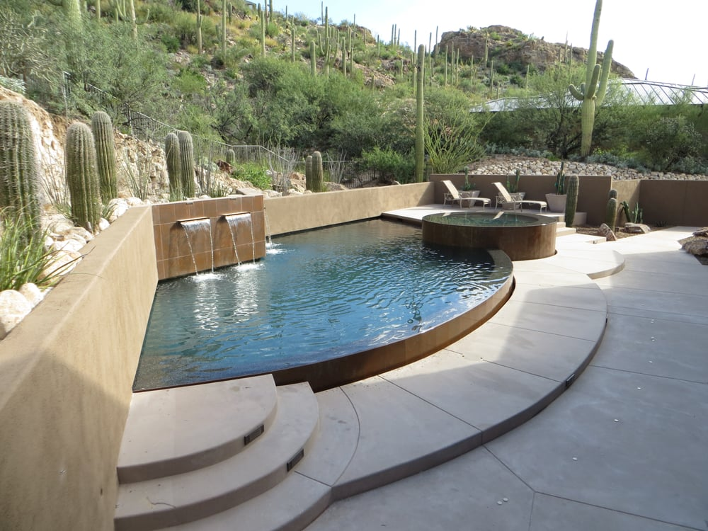 Half Moon Infinite Edge Pool Built On A Hillside With Full