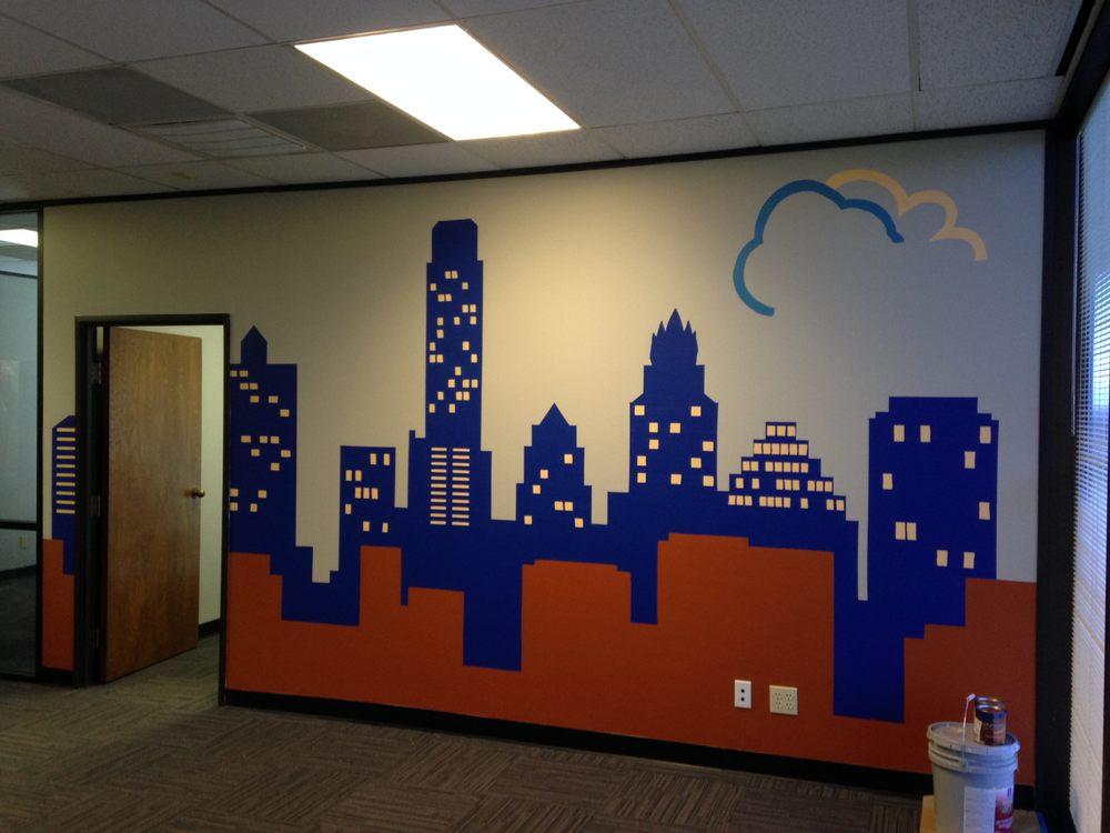 austin skyline office mural company logo in the corner yelp