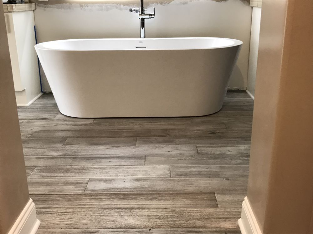 Our durable floors can even go in under your bathtub... beautiful ...