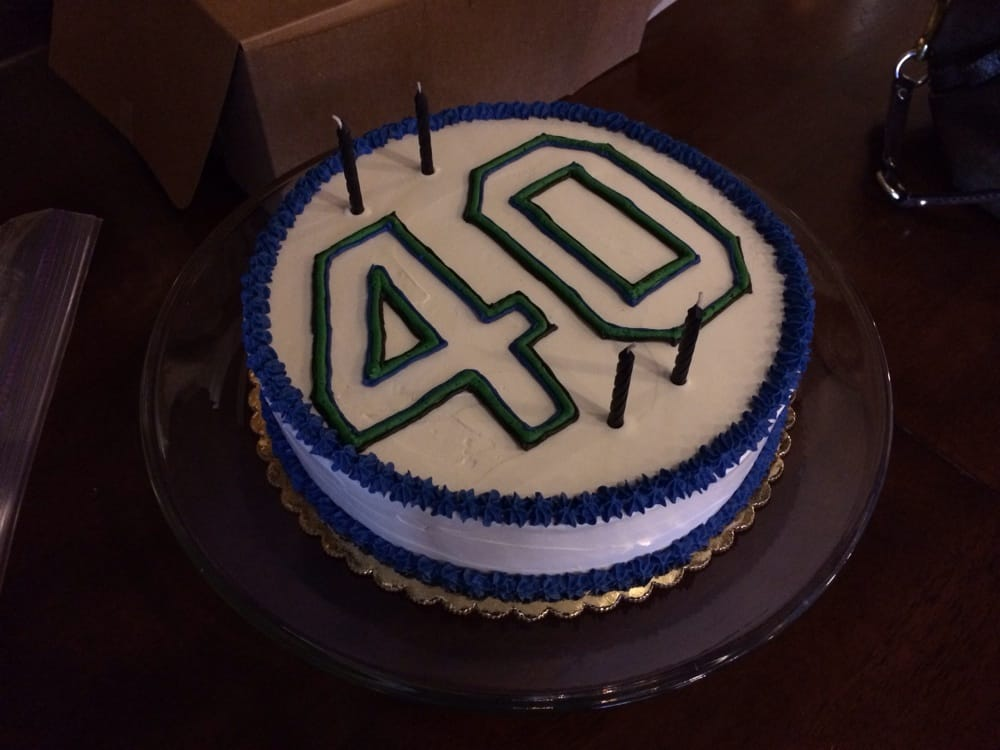 My husband's 40th birthday cake, written like a seahawk jersey