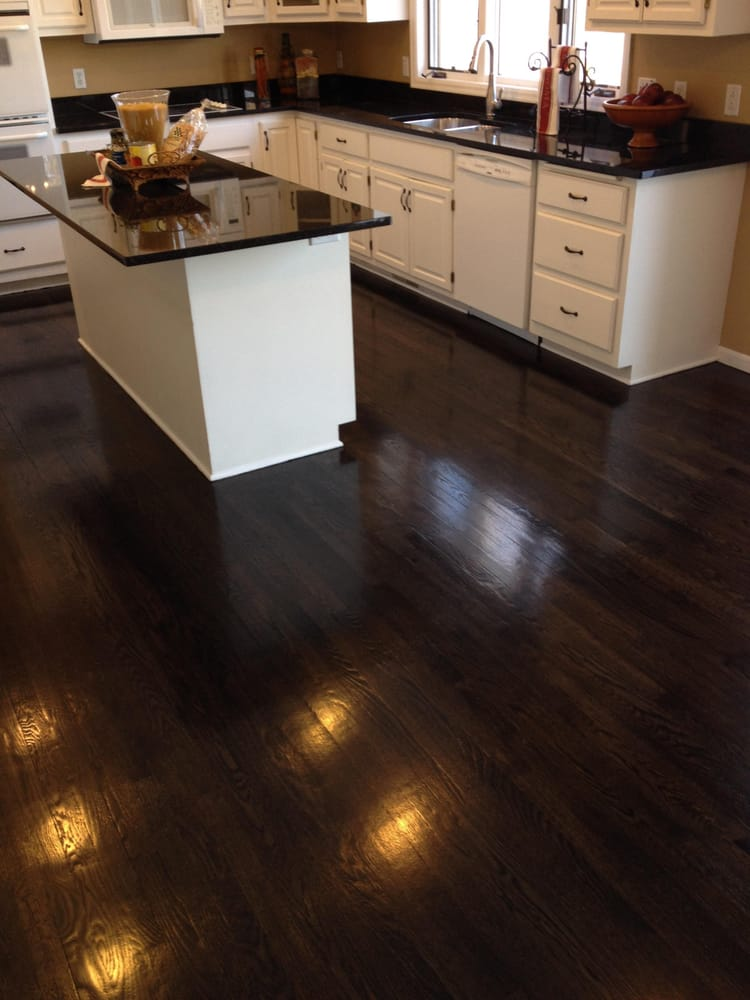 We refinished this golden oak hardwood floor to this for Hardwood floors popping