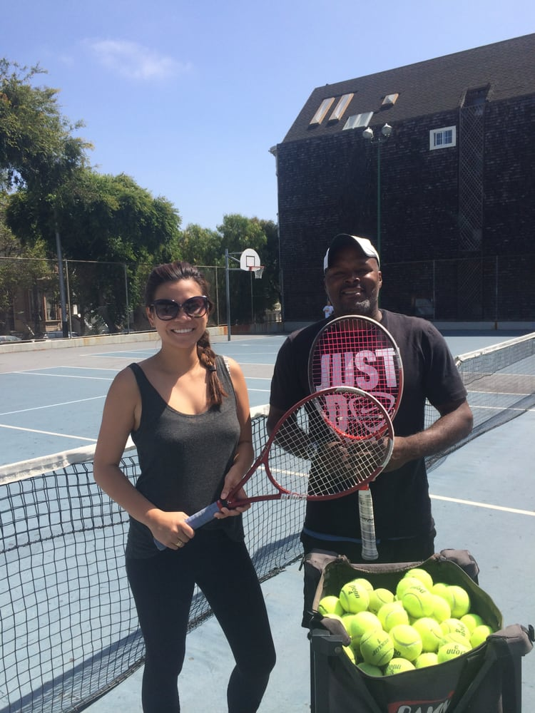 Tennis Lessons By Mcclain - San Francisco, CA, United States. Coach Mcclain and his client Stephanie, has a mean forehand :)
