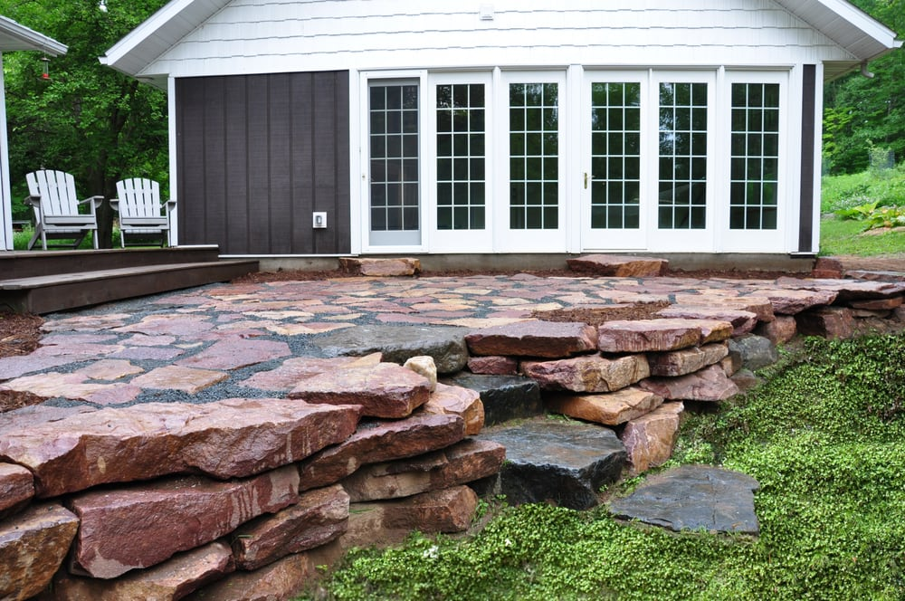 Natural Courtyard Patio And Retaining Wall Located In Holcombe Wi