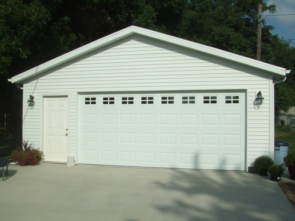 Affordable construction garage door services des for Affordable construction