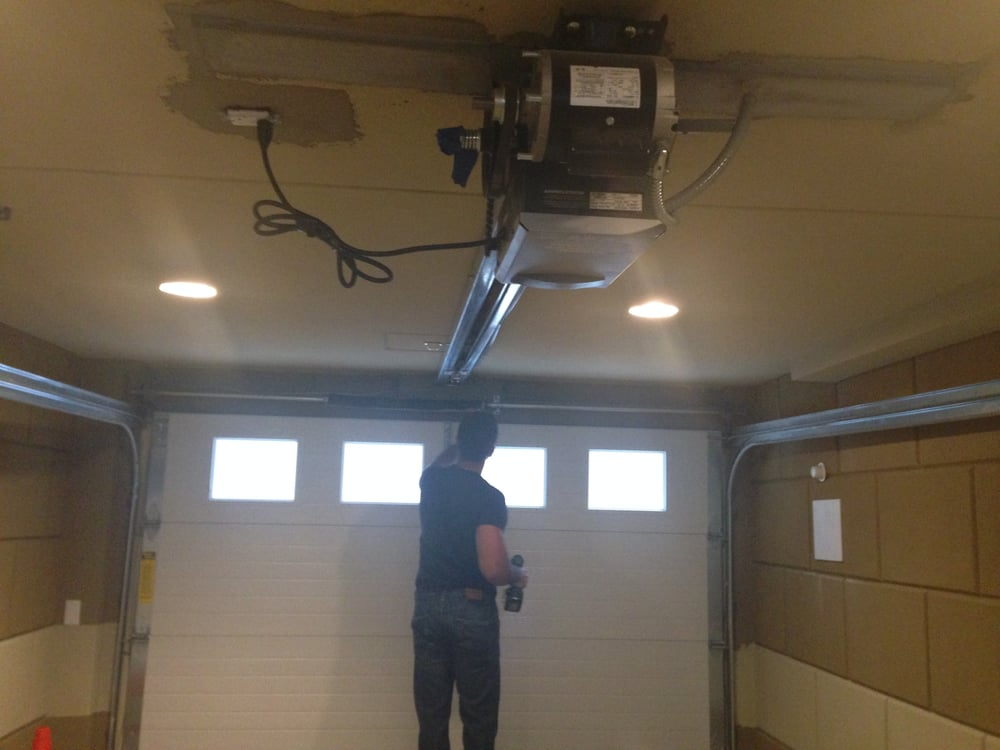 Garage Door In An Apartment Building With A Commercial Lift Master Opener Yelp