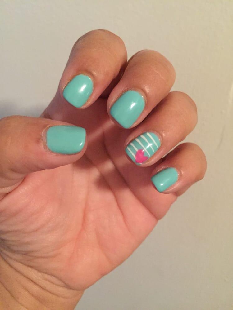 Gel polish manicure in a Tiffany blue color w/design. Regular polish ...