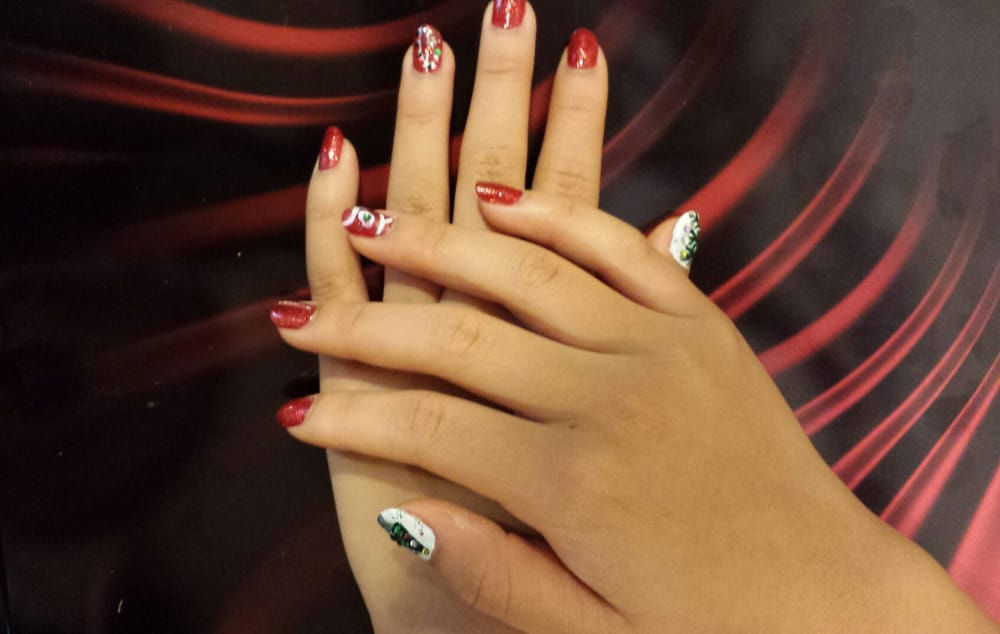 Christmas/New Years Nails! Lasts 2-3 weeks, done by Angie. - Yelp