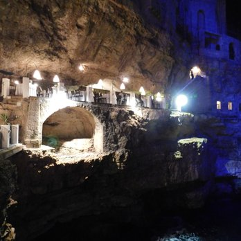 Grotta Palazzese Photos Reviews Italian Polignano A - Restaurant built inside a cave in italy offers beautiful views as you dine