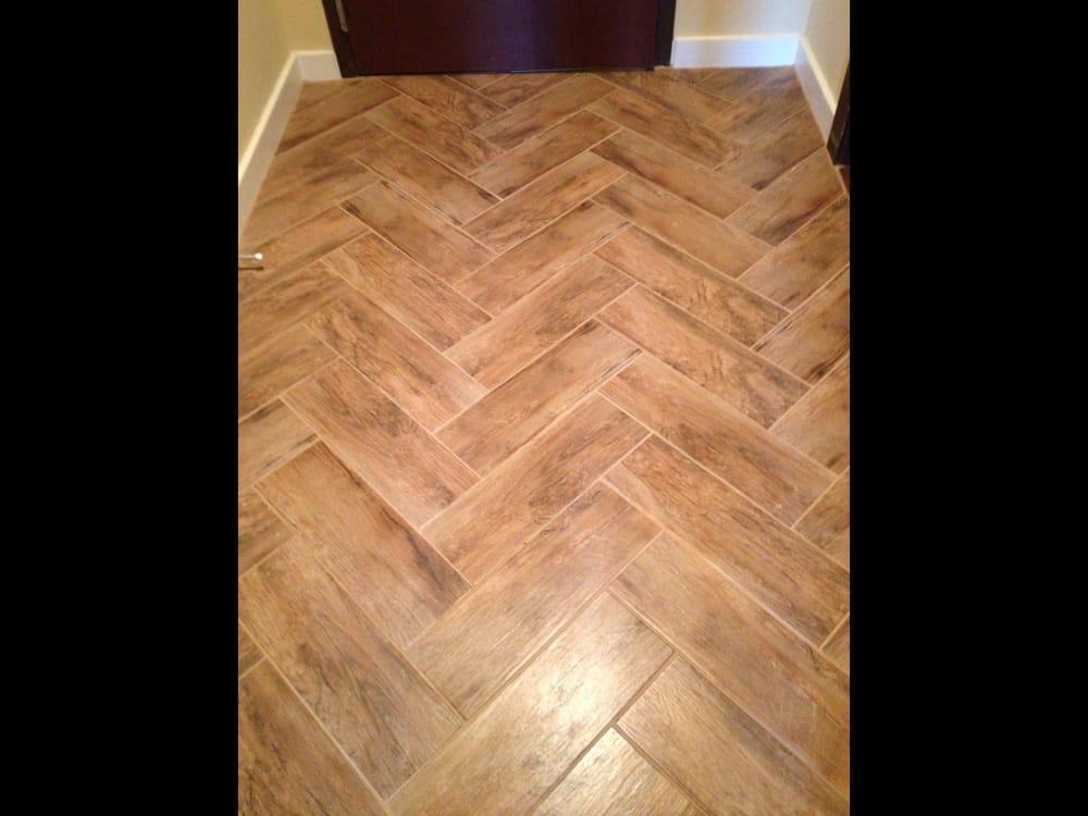 Herringbone pattern in foyer using porcelain wood tile - Yelp