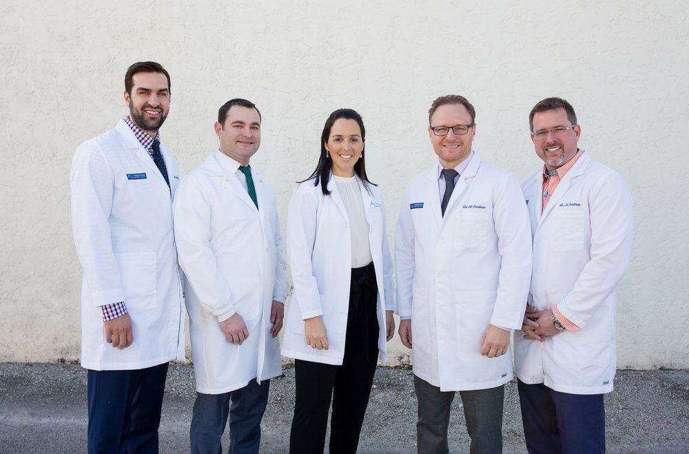 Group Of Prosthodontists Oral Surgeon Periodontist And