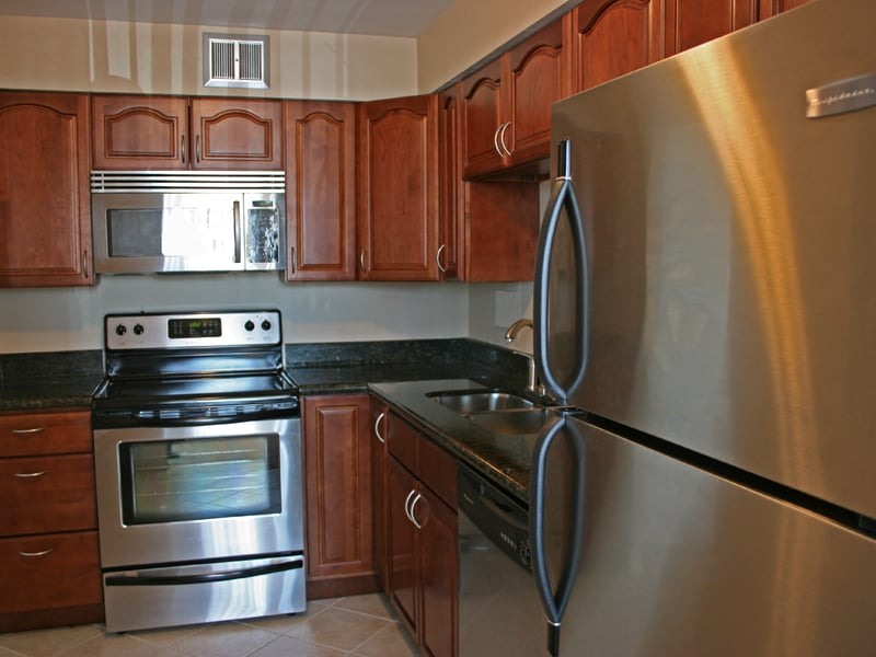 Upgraded kitchens include all stainless steel appliances ...