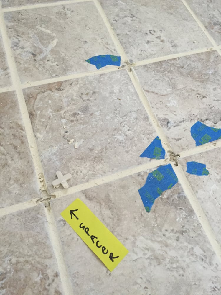 Tile spacers left in bathroom floor and Manny grouted over them ...