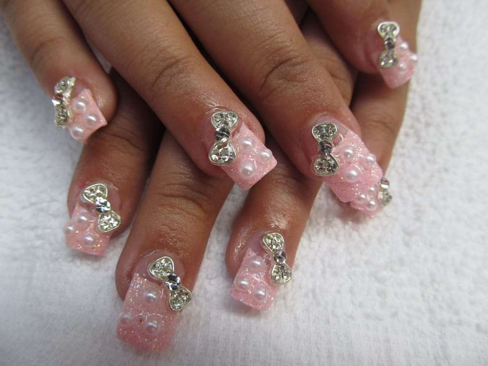 Photo of Nails Unique - Hayward, CA, United States. Bow pearl nail design - Bow Pearl Nail Design - Yelp