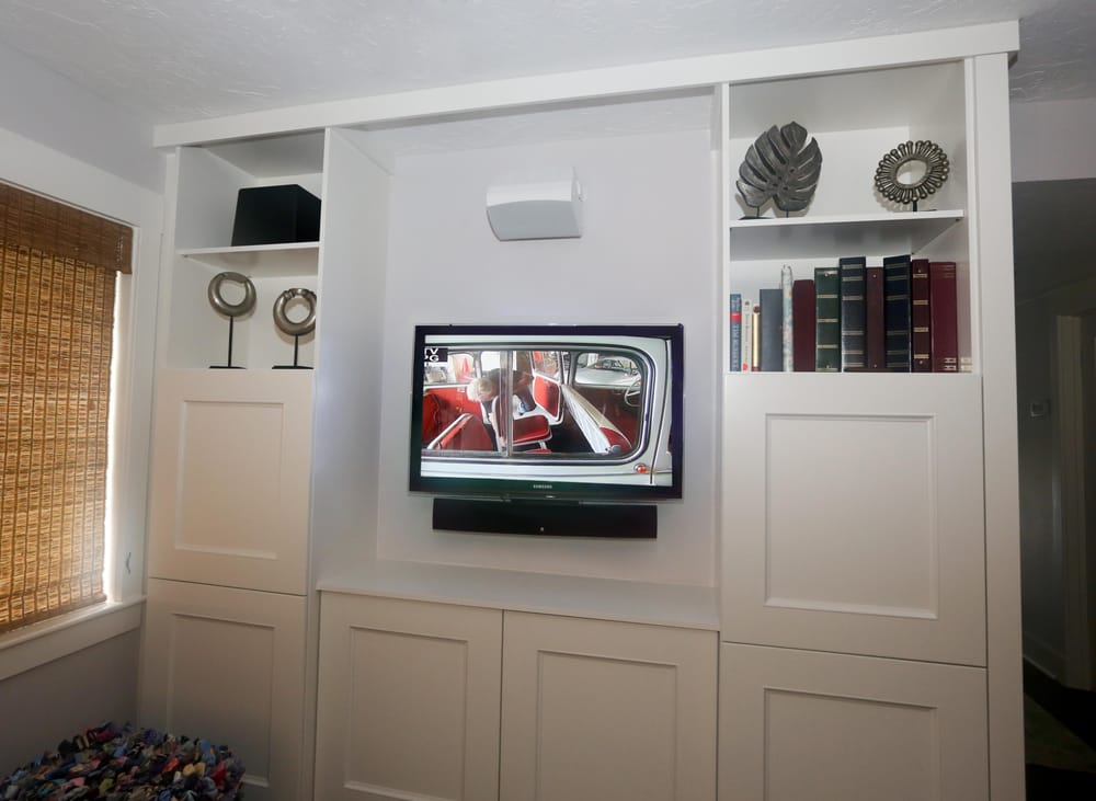 TV Mounted on wall in custom wall unit with Center Channel Speaker ...