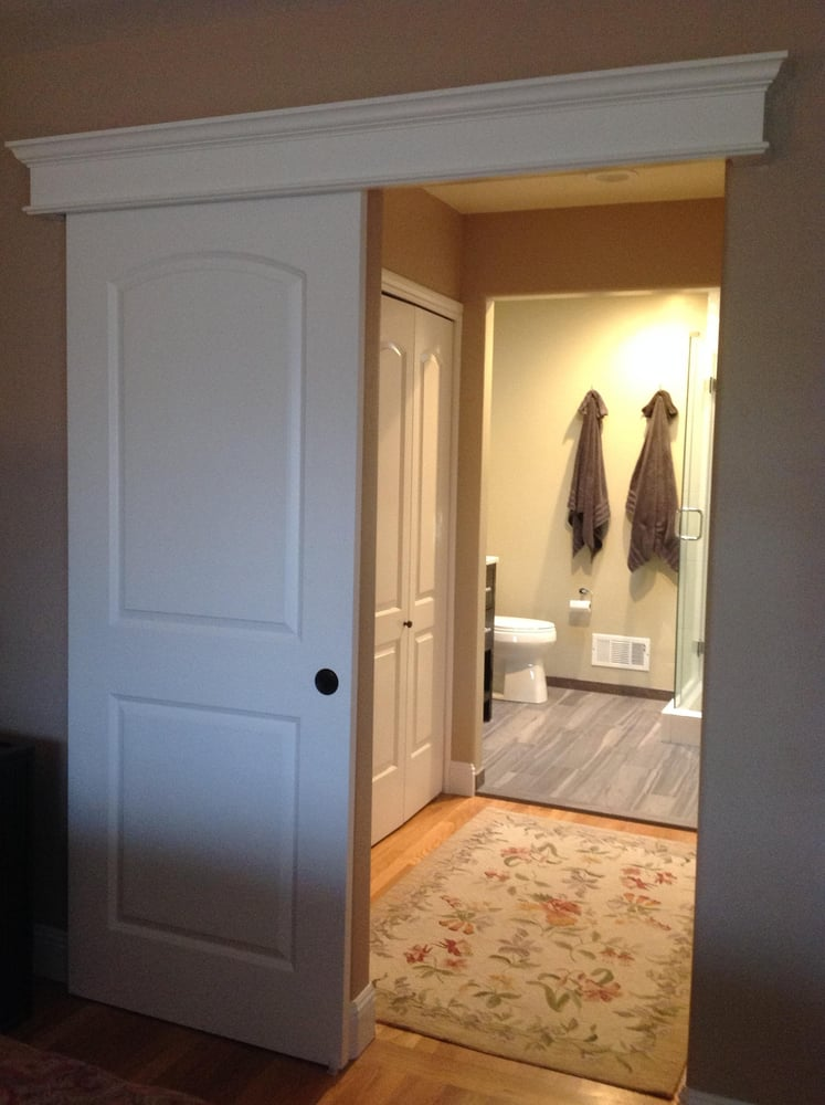 Sliding Barn Door Offering Privacy For Pass Through Master