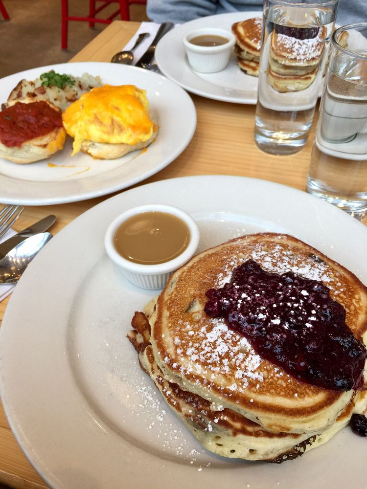 Pancakes with blueberries and biscuit with eggs, cheese ...