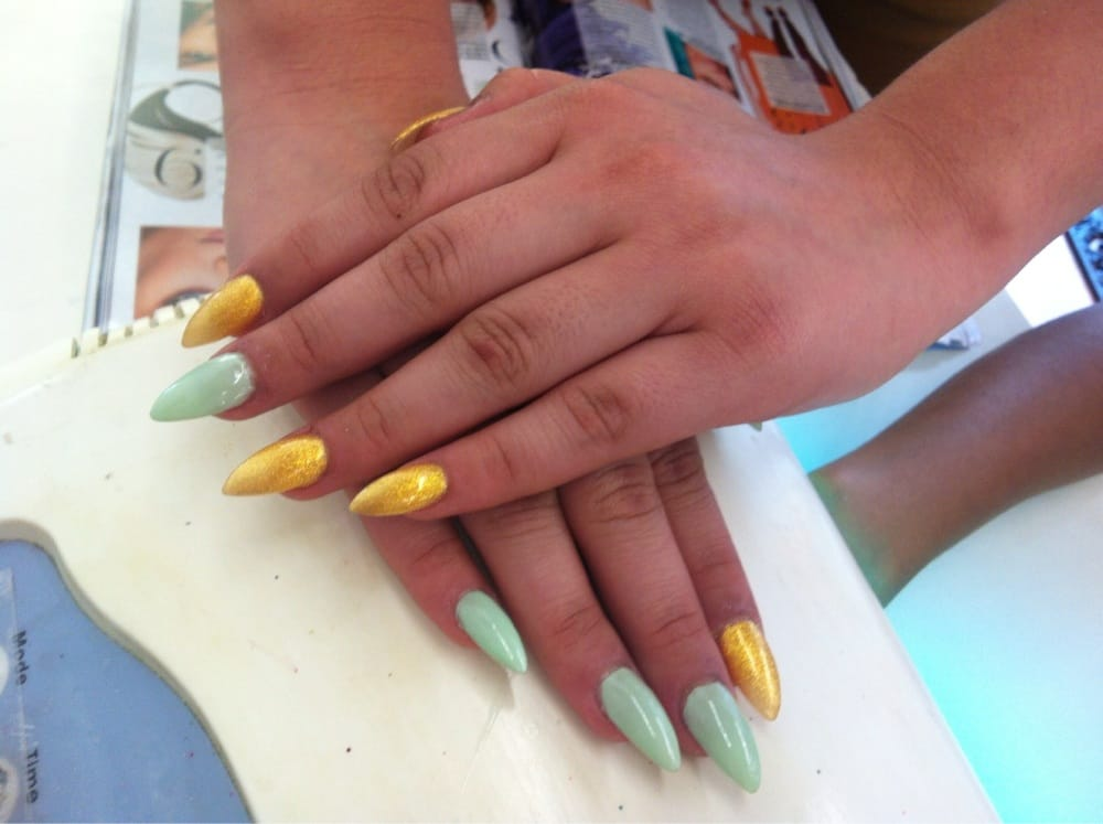 Acrylic nails with yellow and turquoise nail polish I like this ...