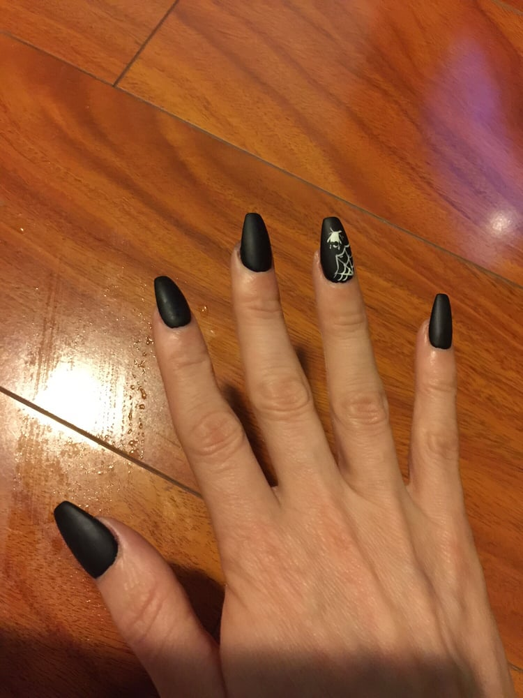 Coffin shaped nails with black matte nail polish and an accent ...
