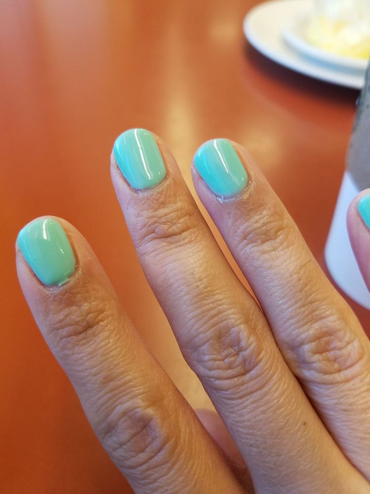 Lady who did my gel manicure was sloppy as shown here. Also left ...