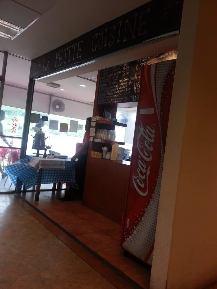 photo of la petite cuisine singapore singapore the restaurant cashier counter and kitchen