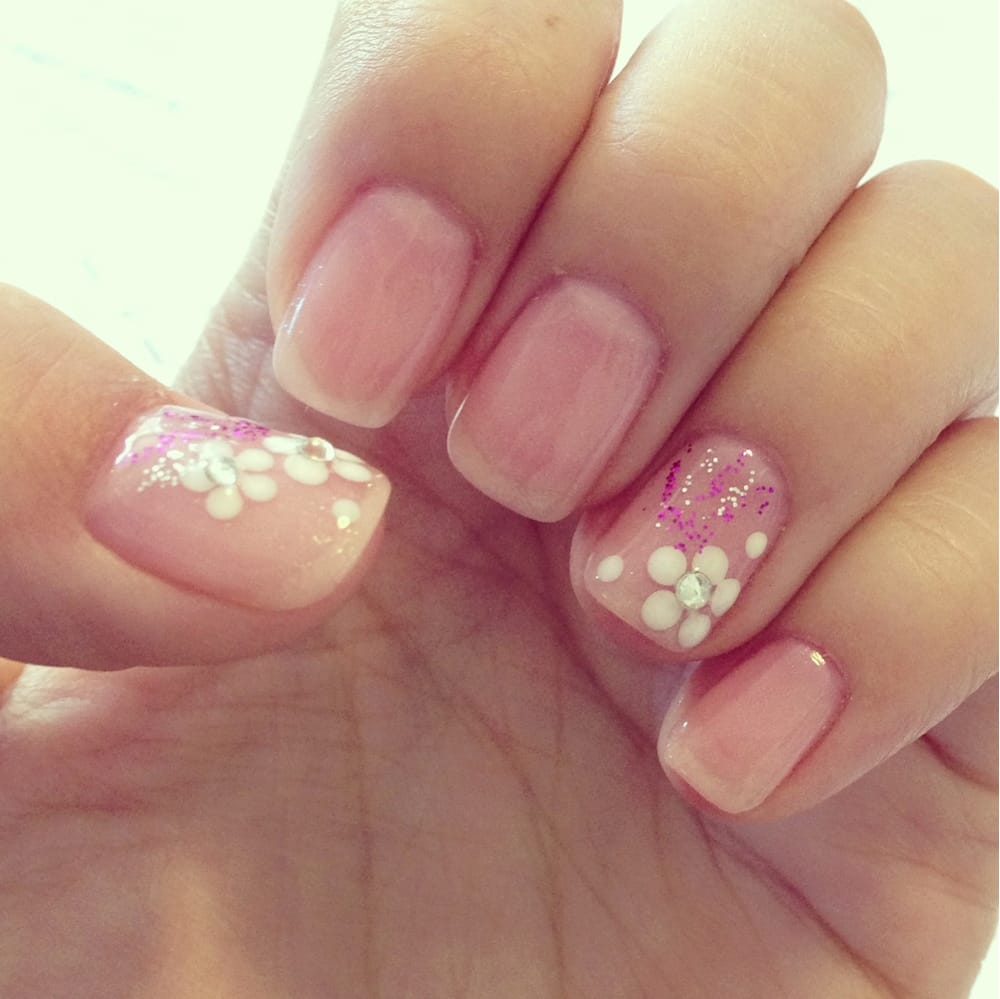 Shellac Manicure Faint Glittery Pink With Flower Designs Should