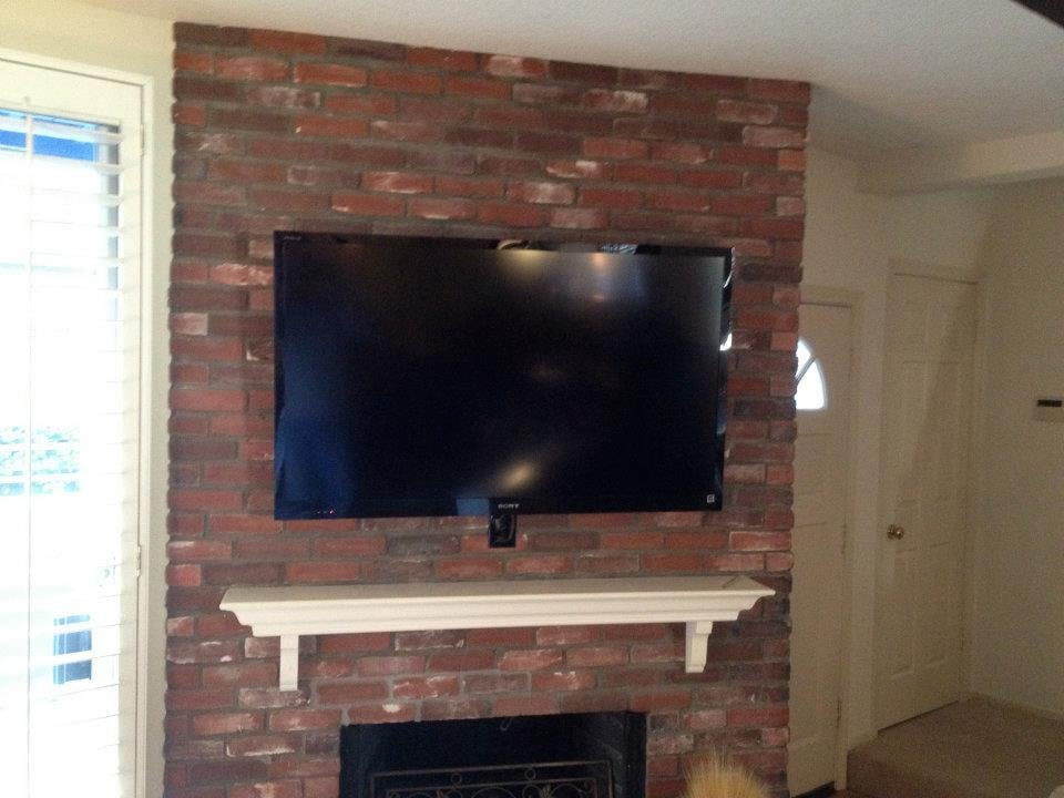 Tv Installation Over Brick Fireplace With All Components Concealed In A Closet Ir System For