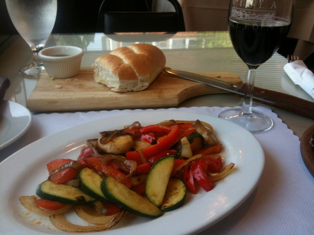 Tasty bread and a side of ok sauteed veggetables yelp for Argentinean cuisine