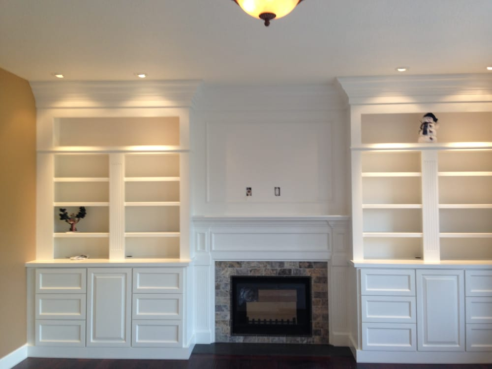 Custom Full Wall Built in Bookcases With TV Mount Over