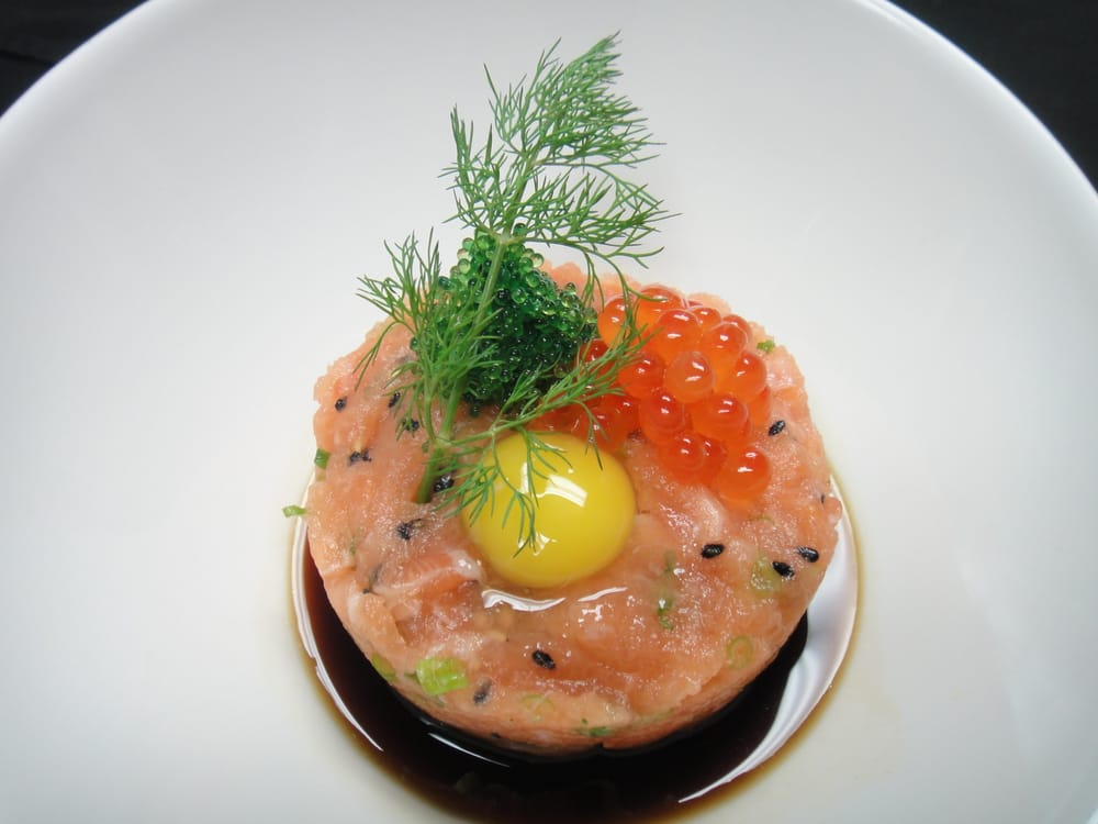 Salmon tartar topped with wasabi tobiko ikura and raw for Nove kitchen and bar