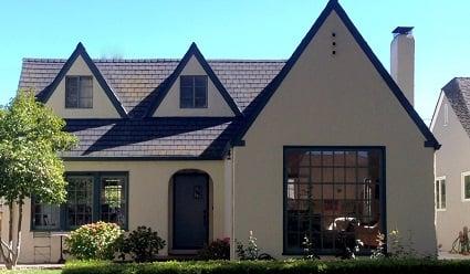 This Semi Tudor Style Home Features Light Tan Stucco