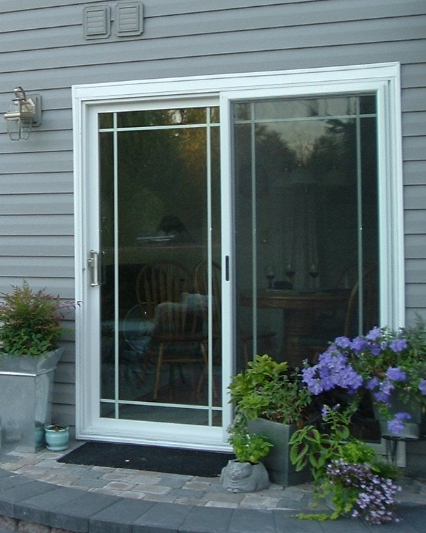 Sliding glass door with french grids and standard 4 point security photo of champion windows and home exteriors of seattle kent wa united states planetlyrics Image collections