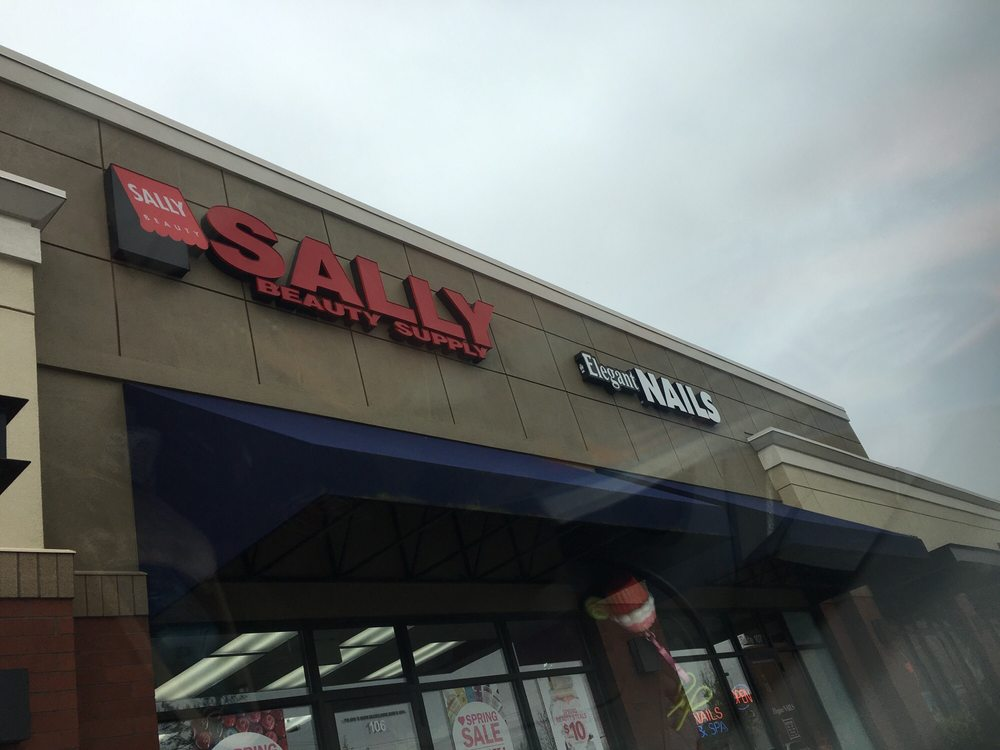 In the strip mall by subway, Bellagios pizza, State Farm & Elegant ...