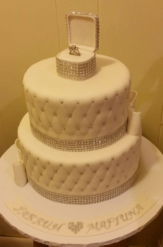 A blinged-out Engagement Cake with The Ring in a blinged-out jewel ...