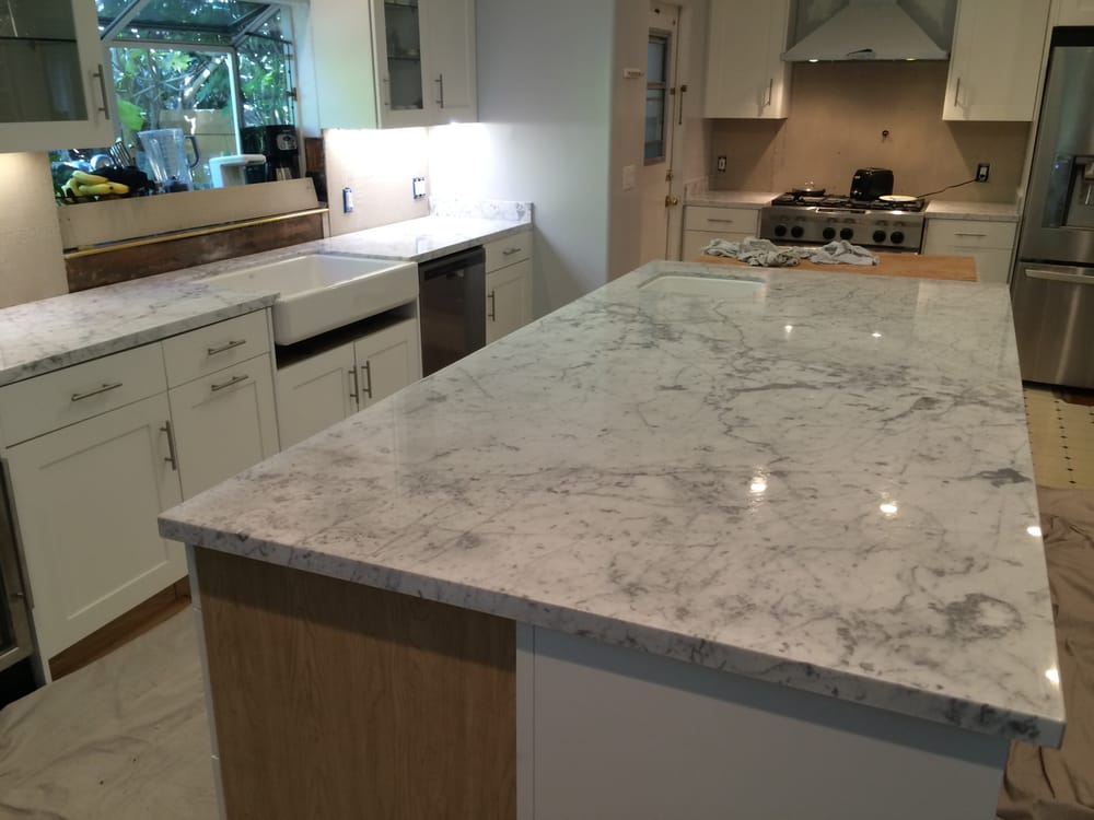 Polished carrara marble kitchen counters with farm sink for Granite countertop support requirements