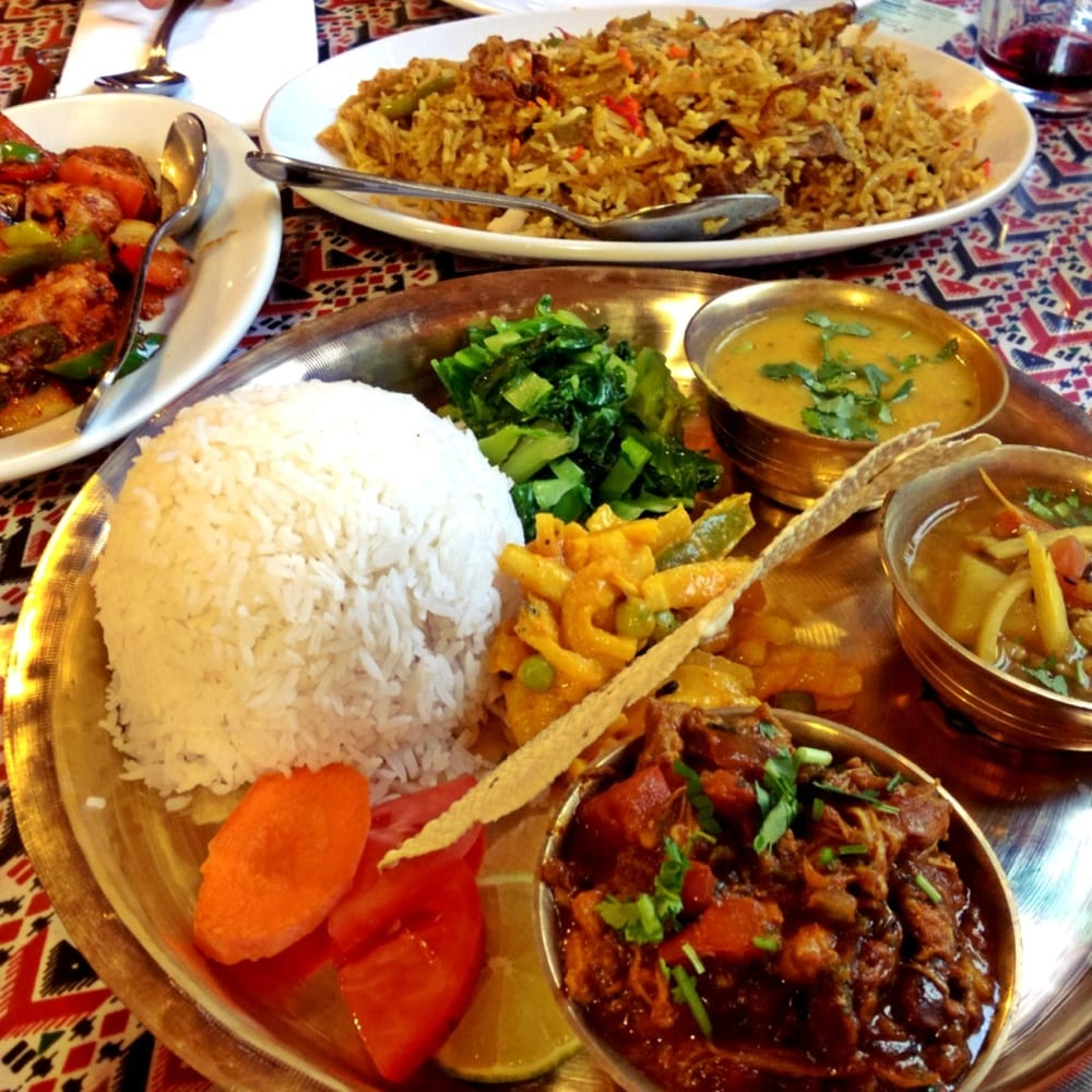 Nepalese Style Thali, Goat Biryani And Chilli Chicken.