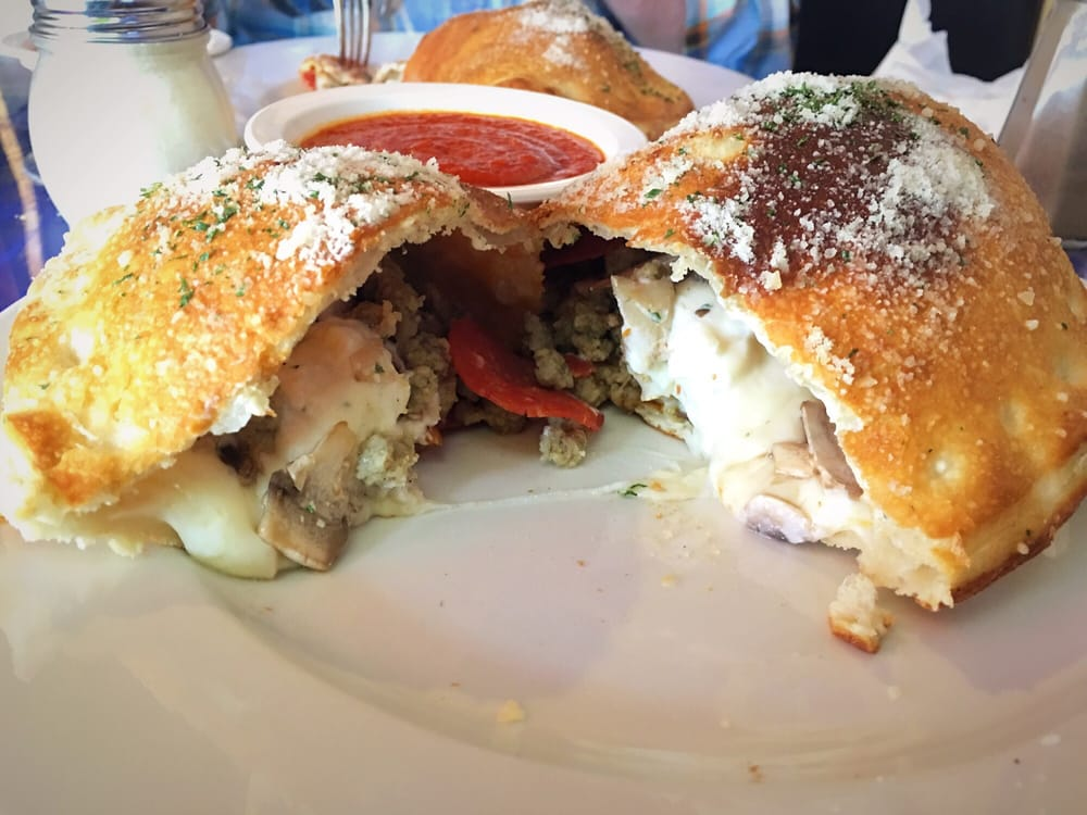 Calzone with sausage ricotta pepperoni and mushrooms delicious yelp for Olive garden duncanville tx 75116