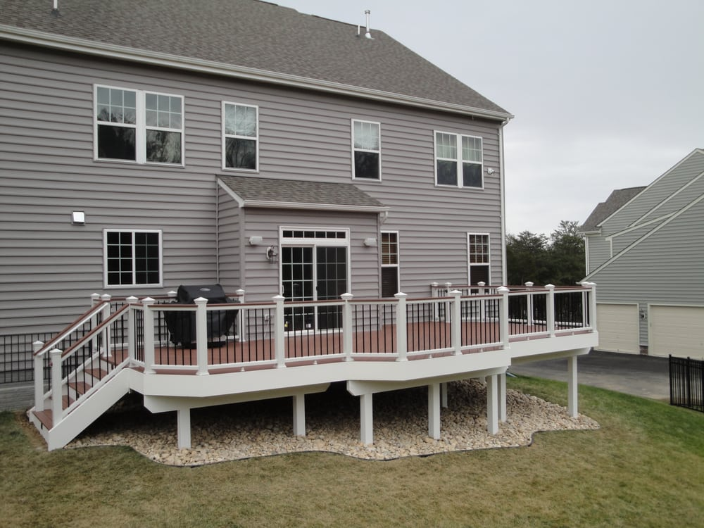 Trex Deck And Railings With Lanscape Stone Under Deck Yelp