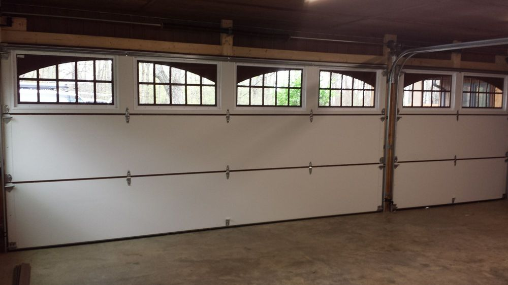 Garage door commander 14 foto servizi per porte di for Concord garage door