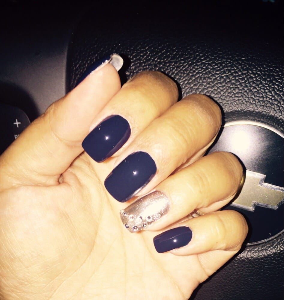 Navy nails with gold and bling ring finger - Yelp