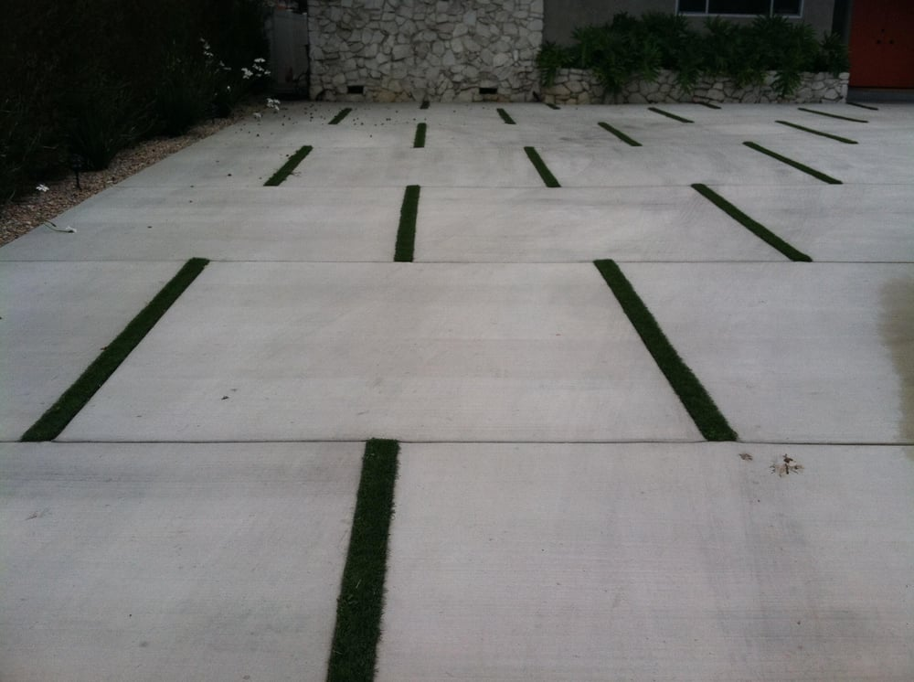 Custom concrete driveway and synthetic grass inlay - Yelp