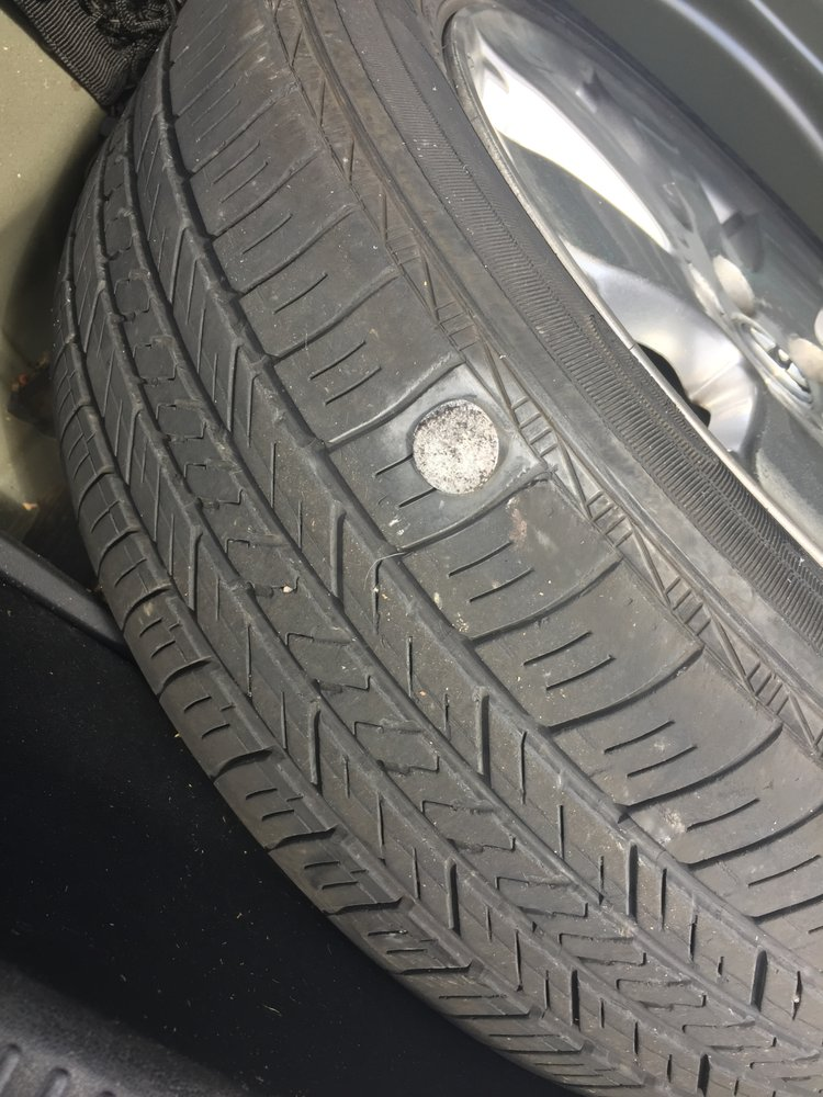 my tire with the nail/spike in it - Yelp