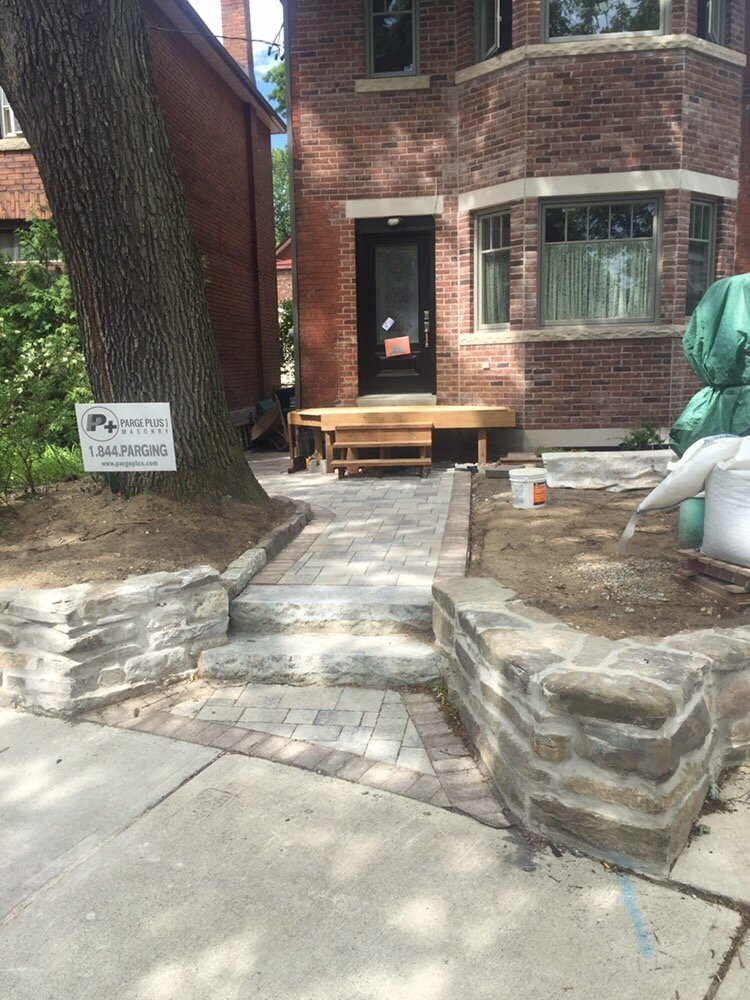 retaining wall restoration new paver walkway and natural stone step